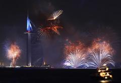 Burj Al Arab 2016 (Adarsh Kuruvath) Tags: new city travel sea beach architecture night canon island 50mm landscapes cityscape fireworks outdoor year uae palm burjalarab jumeirah duba 2016 650d