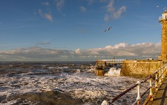 Stormy day on the pier (jack cousin) Tags: sea cloud lighthouse seascape storm pier nikon waves seagull stonework yorkshire wave whitby rails splash railings roughsea d610 crashingwave stormysea foamingsea on1photos
