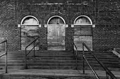 three doors and subsiding steps (fallsroad) Tags: door blackandwhite bw building abandoned architecture doors decay synagogue tulsaoklahoma templeisrael nikond7000