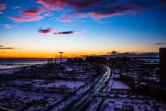 Sunset over Coney Island, NY (Oleg Gonik) Tags: park nyc sunset sky sun newyork beach wheel skyline brooklyn wonder coneyisland amusement pier nikon cityscape peace manfrotto