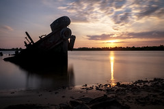 Sunset on the Wreck (fredMin) Tags: travel sunset river boat cambodia long exposure fuji fujifilm wreck fujinon kampot xt1