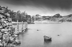 Blea Tarn (Glenn D Reay) Tags: longexposure trees blackandwhite mountains water wall clouds fence mono pentax tarn contrasts langdales blea k30 thelangdalepikes sigma1770hsm 10stopfilter pentaxart glennreay