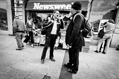 Newswee (Dave G Kelly) Tags: street ireland people blackandwhite dublin woman man horizontal outdoors photography couple day streetphotography newsstand embrace newsweek