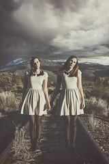 The Other (Alyssa Mort) Tags: portrait woman storm mountains girl dark twins dress outdoor fineart traintracks surreal conceptual alyssamort