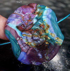 Suzi (Laura Blanck Openstudio) Tags: blue etched usa abstract green art beach glass lines rock stone spiral necklace beads big colorful aqua artist glow purple flat handmade turquoise teal stripes fine arts violet lavender funky holes made odd pebble lilac earthy single round huge periwinkle opaque bead swirl amethyst wearable mermaid urchin murano lampwork multicolor raku artisan pendant whimsical nugget frosted frit openstudio asymmetric ocher focal tumbled indentations organich openstudiobeads