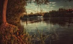 Am Main... (hobbit68) Tags: old bridge sunset sky clouds river boats wasser outdoor alt frankfurt sommer main himmel wolken haus boote ufer fluss sonne dach bltter baum gebude sonnenschein brcken dcher