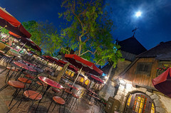 Disneyland: Dining Under the Moonlight (Jessie Chaisson) Tags: red moon colors jessie night photography restaurant nikon disneyland umbrellas chaisson