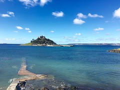This is St Michaels Mount ... The English brother to Mont St Michel in Normandy. When the tide is low you can cross by foot. (Seymour Travels Small Group Tours) Tags: light sea england water travels cornwall tour britain religion coastal guide stmichaels penzance seymourtravel