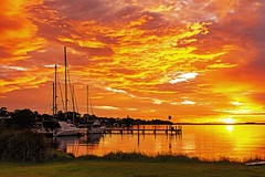 Skies on Fire (Sterling67) Tags: reflection water clouds sunrise pier stormy yachts lakemacquarie wangi