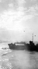 View of Omah Beach Normandy; taken from USS LCI (L) 542.  Ship in foreground is USS LCI (L) 420. (HarryKidd) Tags: ww2 landingcraft dday omahabeach