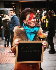 At the David Bowie mural in Brixton, after the announcement of his death (oldrockerward) Tags: street flowers blue red pierced people woman london girl rock scarf hair nose death fan lyrics mural pretty message mourning coat femme crowd stripe streetphotography makeup stranger piercing human glam tribute blaze lightening frau guapa blackboard brixton mdchen alternative suede davidbowie septum individual aladdinsane dziewczyna thedame groover pikny kvinna  seksowny kvinnlig rosielowery ohnoloveyourenotalone 11january2016
