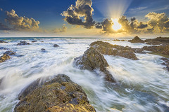 Morning in the East Coast. (Nadly Aizat) Tags: ocean morning travel blue winter light sunset sea vacation sky orange cloud sunlight holiday seascape color tourism ice beach nature water beautiful rock stone clouds sunrise landscape outdoors dawn bay coast seaside sand scenery rocks pretty waves outdoor south sandy horizon rocky australia scene coastal malaysia environment coastline geology seashore idyllic terengganu mys kualaterengganu