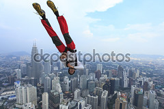 Kuala Lumpur, Malaysia-September 30, 2011: A BASE jumpers in jumps off from Kuala Lumpur Tower. KL Tower BASE Jump is an annually event and participants from experienced BASE jumpers from all around the world.. (ludmilaharrokardenaslazaro jarro) Tags: city blue summer sky cliff color tower nature beautiful sport rock danger sunrise skydiving outdoors person one fly high jump risk view shanghai angle action vibrant low extreme diving adventure malaysia passion jumper motivation kuala satisfaction activity kl parachuting base challenge lumpur parachute courage selfie recreational exhilaration basejump