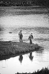 Fisherman's friends (Jani M) Tags: bw water fishing fisherman reflction