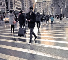 Crossing 23rd and Broadway 2 [detail] (sjnnyny) Tags: family urban walking trafficlight cityscape luggage pedestrians crosswalk shoppers meltedsnow grii ladiesmile commercialdistrict stevenj midtownny manhattanstreets januarynyc flatiorndistrict sjnnyny streetnyclife