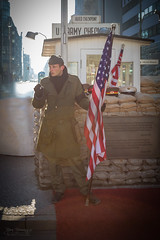 Bradley on duty (Normann Photography) Tags: street berlin germany de army gate outdoor cigarette flag military smoke social hero safe luckystrike powerful starsandstripes authentic historicplace checkpointcharlie checkpoint ussoldier vigilant retrospect 2016 watchful onguard onduty