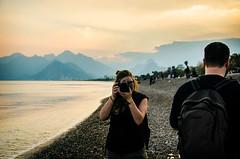 One of us is Joy (Melissa Maples) Tags: sea mountains beach water turkey evening spring nikon asia mediterranean photographer dusk trkiye joy josh antalya nikkor vr afs  18200mm  f3556g  18200mmf3556g d5100 konyaaltbeach konyaaltzero