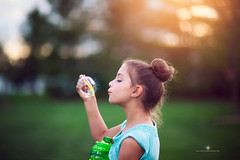 (Rebecca812) Tags: portrait cute nature girl beautiful childhood canon outdoors evening blow nostalgia lensflare sideview playful bun blowingbubbles colorcontrast bubblewand burstbubble canon5dmarkii rebecca812