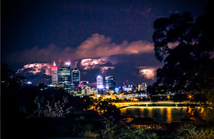 Lightning in the Distance (Lennixx) Tags: longexposure sky silhouette yellow skyline clouds reflections lights moody cityscape purple dramatic australia latenight multipleexposure perth wa lightning storms thunder swanriver splittone kingsparkbotanicalgardens verycolourful