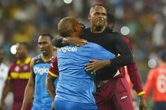 Head coach Phil Simmons embraces Marlon Samuels (westindiescricket) Tags: india kolkata