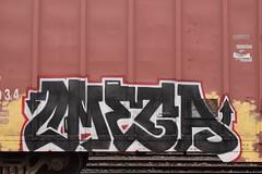 OMEGA (TheGraffitiHunters) Tags: street red white black art train graffiti colorful paint omega tan tracks spray boxcar freight benched benching