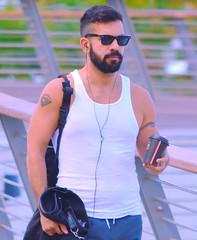 Wife Beater (Alan46) Tags: man sexy guy tattoo beard israel telaviv beefy handsome hunk jeans tanktop boardwalk shorts macho guapo stud hunky built wifebeater scruff unshaved brawny buffed bitchin
