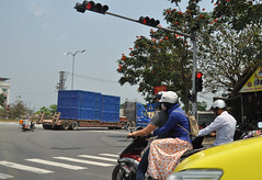 Safety first (Roving I) Tags: trees trafficlights control transport safety vietnam trucks loads danang logistics helmets motorscooters facemasks pedestriancrossings