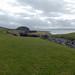 Midhowe Cairn behind Midhowe Broch
