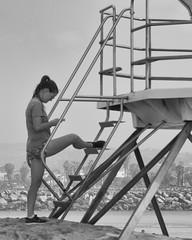 P1000295-bw (A.C.Elliott) Tags: california white black beach girl oceanbeach runner lifeguardtower