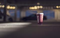 Costa Living. (Matt_Briston) Tags: park light red costa cup car lights bokeh shaft