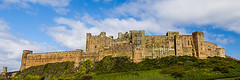 Imposing Bamburgh Castle_ (Brian Travelling) Tags: england sky castle stone clouds historic northumberland mound bamburgh bamburghcastle