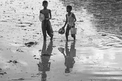 Catching fish ( / Gypsy) Tags: blackandwhite boys monochrome childhood joy happiness boyhood catchingfish joyofchildhood