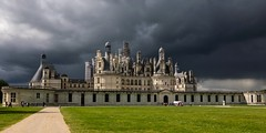 The royal Château de Chambord (Lena and Igor) Tags: road light people sun storm france building castle field grass architecture clouds landscape path dramatic tourists chambord loire château nikonflickraward nikonflickrawardgold flickrtravelaward