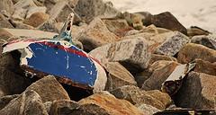 Lost / Found.. (Michael C. Hall) Tags: sea broken wall boat rocks break colours damage granite rowing wreck fibreglass dashed