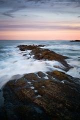 Sunset on the Horsehoe (Damon Finlay) Tags: sunset seascape water rock landscape coast scotland movement rocks fuji bass north east forth horseshoe northberwick berwick fujinon lothian firth firthofforth bassrock eastlothian xe1 watermovement f284 fujixe1 xf1855mm xf1855mmf284