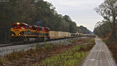 On a rainy sunday morning when most people would still be home and in bed, I set out to get CSX W815 a loaded military train with KCS power. Had it been sunny this shot and many others would not have worked so the weather actually helped me with this one (MrRailfan) Tags: railroad florida military rr belle fl callahan csx kcs emd sd70mac sd70ace w815
