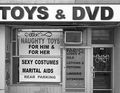 Toys & DVD (L_) Tags: blackandwhite bw toronto shop store storefront queenstreet shopfront queenstreeteast topw501
