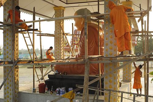 Four Monks repainting  their Religious Icon.