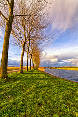 The Shadowside Of It (Alfred Grupstra Photography) Tags: road trees light sky green water grass clouds landscape canal nikon nederland nl medemblik noordholland
