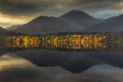 In the Line of Light (Vemsteroo) Tags: morning travel autumn lake mountains reflection nature water beautiful sunrise canon outdoors derwent lakedistrict dramatic hills cumbria fells 5d serene derwentwater colourful epic f4 70200mm mountainscape mkiii circularpolariser visitengland leefilters visitbritain