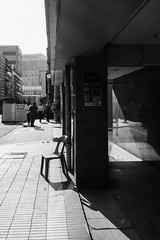 Hot seat (asaresult) Tags: street city light people urban blackandwhite monochrome photography chair singapore fuji shadows streetphotography sunny quay clarke x20 2015
