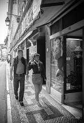 distrait (Jack_from_Paris) Tags: street bw angle noiretblanc lisboa femme wide olympus contraste pancake monochrom mermaid capture asph f25 ville homme omd regards lisbonne distraction lightroom 14mm em5 nx2 p4240278bw