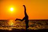 grab the sun (T_2wice) Tags: ocean life sunset red sea portrait sky orange woman sun reflection beach water yoga pose outside fire evening sand nikon florida dusk spirit sunny adventure zen frame handstand om sen namaste