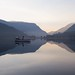 Mirror sunrise reflection on padarn lake.