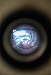 The World Through a Peep Hole (Greg Vierra) Tags: walkway peephole frontporch parkedcar unusualview distortedreality circularperspective