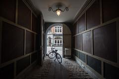 Natural framing (nesnetsirhc) Tags: old light bike bicycle bulb copenhagen denmark exposure darkness natural symmetry doorway framing portals