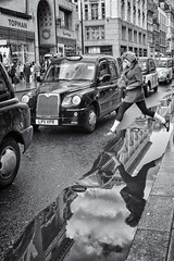 Leap of faith (mcb photography) Tags: street city urban reflection london shopping cab taxi streetphotography oxfordstreet londontaxi leapoffaith londoncab mikebarber mcbphotography wwwmcbphotographycouk
