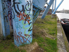2016.04 - Amsterdam photo, graffiti on columns of an old port-crane at the former ship-yard of Werkspoor, at Oostenburg, canal Wittenburgervaart; - geotagged free urban picture, in public domain / Commons; Dutch photography, Fons Heijnsbroek, Netherlands (Amsterdam photos, pictures, foto's - Netherlands) Tags: crane installation shipyard werkspoor oostenburg steel columns amsterdam industrial old view canal wide wittenburgervaart city public domain photo picture free print image geotagged dutch photography outdoor tags quay blue urban publicdomain publiekdomein nocopywright freedownload freeprint printforfree fonsheijnsbroek ccophotography freephotos photofree opensourcephotos thenetherlands photographer dutchphotographer urbanphotographer urbanphotoart urbanphoto dutchphoto dutchphotography urbanphotography commons amsterdamcity highresolution goodquality printfree wittenburg pillars canalborder water impression pic