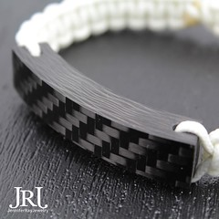 Closeup. Look at those waves and weave! Made from solid carbon fiber. #jenniferrayjewelry #jrjcarbon #jrj #carbonfiber #carbonfibre #mensgear #menstyle #menwithclass #fashion #edc #everydaycarry #usntagram #usn #wristshot #armcandy #armswag (JenniferRay.com) Tags: ray jennifer jewelry carbon custom fiber exclusive paracord jrj instagram