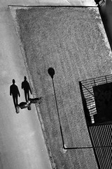 Diagonal stroll (Jani M) Tags: street shadow urban bw walking person